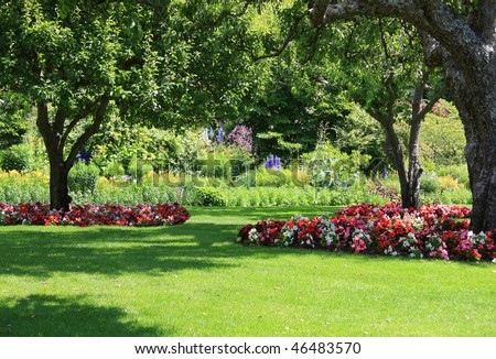 Beautifully manicured park garden in summer. - stock photo