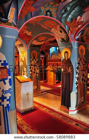 Beautifully painted interior of a small russian orthodox church - stock photo