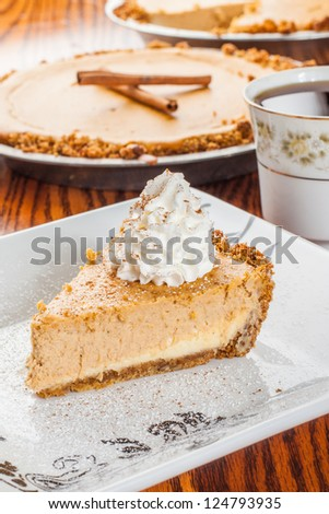 Beautifully plated slice of pumpkin pie - stock photo