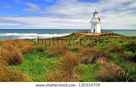 Beautifully restored heritage building of Waipapa Point Lighthouse on The Catlins coast on South Island of New Zealand - stock photo