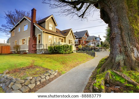 Beautifully restored old craftsman style home. - stock photo