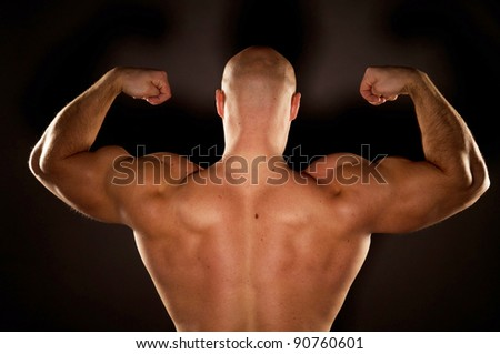 beautifully sculpted bodybuilder - stock photo