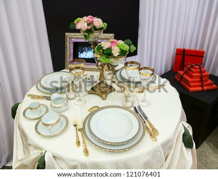 Beautifully served table for banquet and red gift box - stock photo