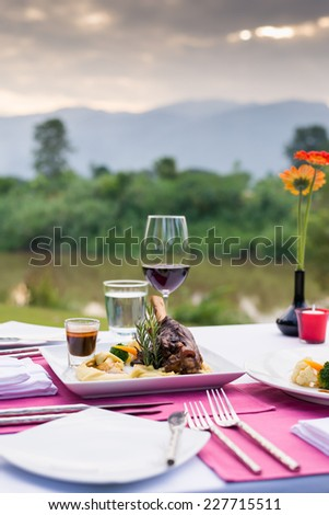 beautifully served table in a outdoor restaurant - stock photo