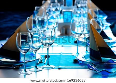beautifully set table at a fish restaurant - stock photo