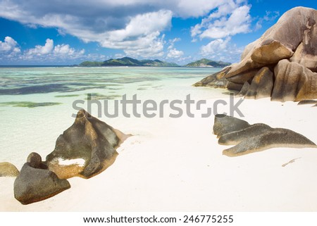 Beautifully shaped granite boulders and a perfect white sand at Anse Source d'Argent beach, La Digue island, Seychelles - stock photo