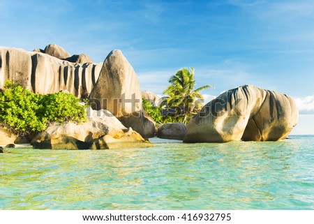 Beautifully shaped granite boulders reflecting in the water at Anse Source d'Argent beach, La Digue island, Seychelles - stock photo