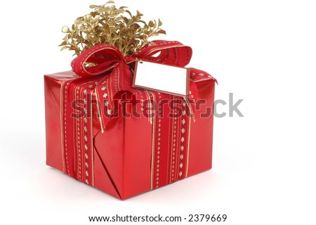 Beautifully wrapped present in red and gold.