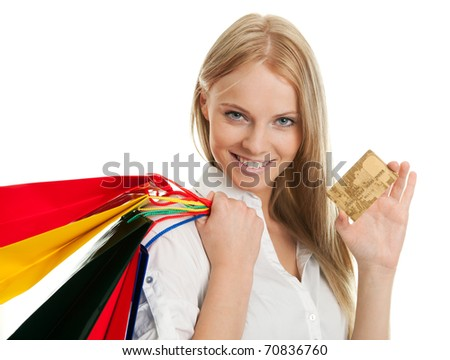 Beautilful young woman carrying shopping bags - stock photo