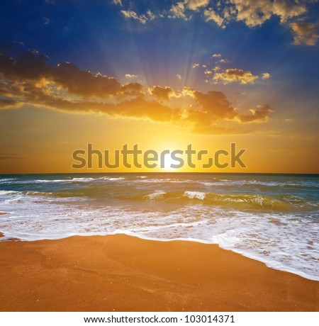 beautisul sunset on a sea beach - stock photo