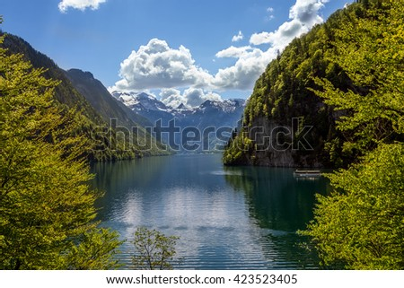 Beautiul view of Koenigssee from the North shore of the lake with a ship travelling on it