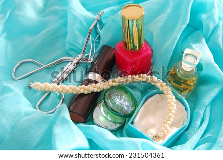 beauty accessories on blue scarf - stock photo