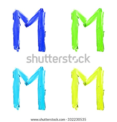 "Beauty alphabet set - blue, green and yellow dye letters isolated on white background. ""M"" letter. - stock photo"