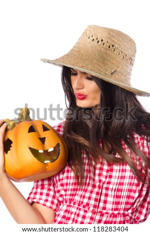 Beauty and a Pumpkin - Attractive girl in a vintage dress and a straw hat holding a Halloween pumpkin