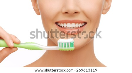 beauty and dental health concept - beautiful woman with green toothbrush - stock photo