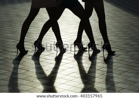 Beauty and fashion, body parts. Female legs in fashionable shoes silhouette.