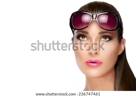 Beauty and Fashion Concept - Close up Pretty Young Woman with Long Straight Hair Wearing Stylish Red Violet Shades on Forehead, Looking up. High fashion portrait Isolated on White with Copy Space - stock photo