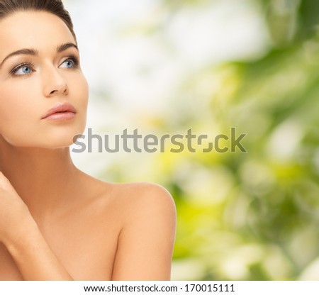 beauty and health concept - beautiful woman looking up - stock photo