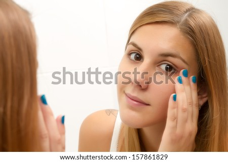 Beauty and health of young woman in the bathroom - stock photo