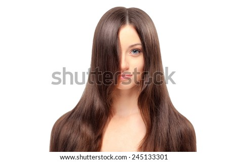 Beauty and health. Portrait of young beautiful woman with long magnificent hair on white background
