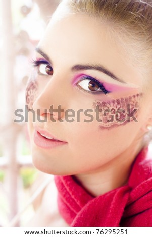 Beauty And Makeup Concept With The Face If A Beautiful Pretty And Young Woman Wearing Artistic Floral Or Flores Design Make Up Representing Creative Cosmetics - stock photo