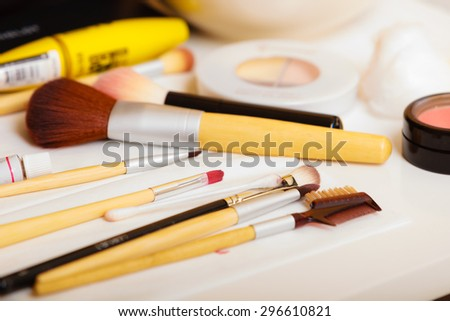 Beauty and makeup. Make up set  brushes and various decorative cosmetics on table - stock photo