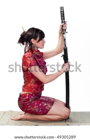 beauty and resolute asian girl with katana isolated on white background