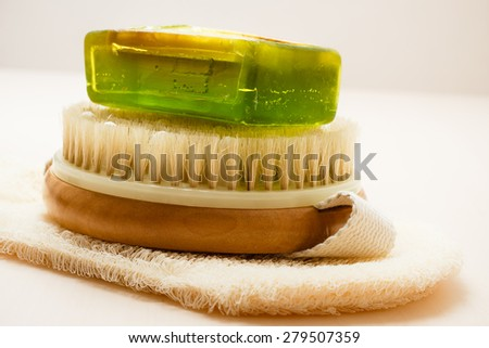 Beauty and skin care. Closeup spa products bath accessories scrub brush soap and massage glove on wooden table. - stock photo