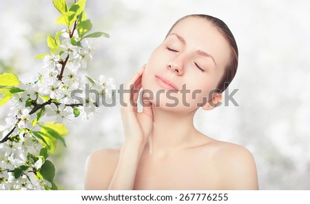 Beauty and skin care concept - portrait of beautiful young woman enjoying pure fresh skin - stock photo