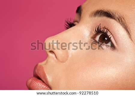 Beauty And Skin Concept Subtle Makeup. Closeup of a beautiful young woman wearing subtle and natural makeup, profile with lovely complexion. - stock photo