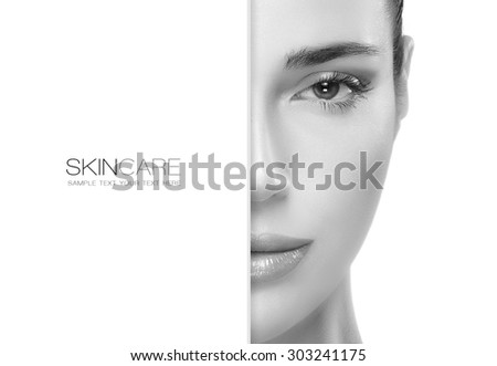Beauty and skincare concept with a half face portrait of a gorgeous woman with healthy clean skin and blank copy space alongside with sample text. Template design - stock photo