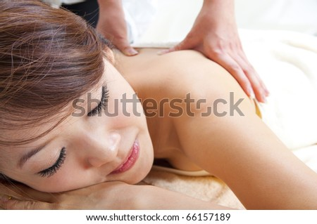 Beauty and Spa - Asian Girl having a massage on her back - stock photo
