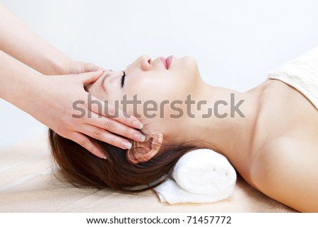 Beauty and Spa - Asian Girl having a massage on her head - stock photo