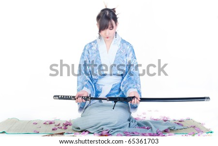 beauty and submissive geisha in blue kimono with katana on white background