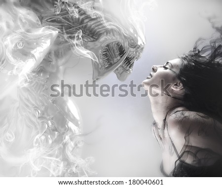 beauty and the beast, beautiful woman kissing a monster - stock photo