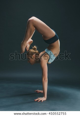 Beauty and young woman practice yoga in the studio