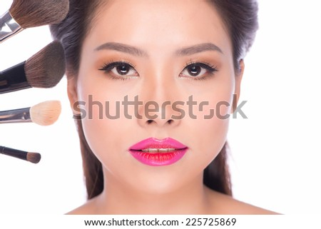 Beauty Asian Woman Portrait. Professional Makeup for Brunette with Blue eyes - Red Lipstick, Smoky Eyes. Beautiful Fashion Asian Model Girl. Perfect Skin. Make up. Isolated on a White Background. - stock photo