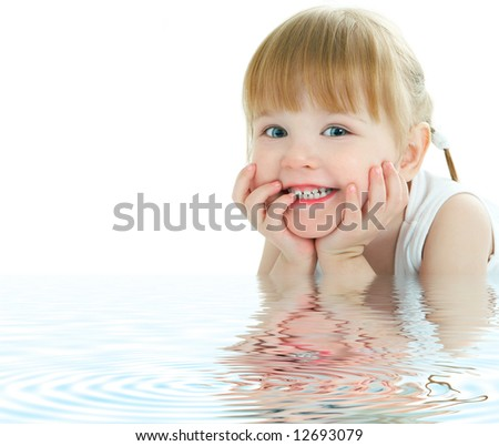 beauty baby face with ripples in the water - stock photo