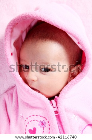 Beauty baby on pink hood, Head and shoulders portrait - stock photo