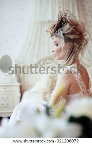 beauty blond emotional bride in luxury white vintage interiors