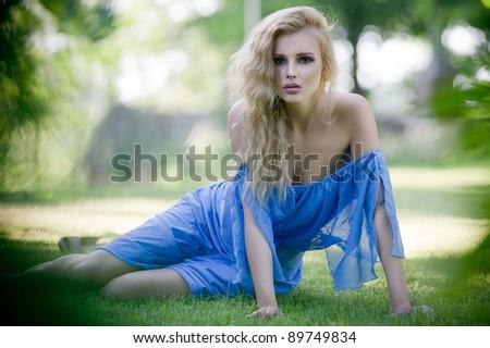 Beauty blond lady in garden - stock photo