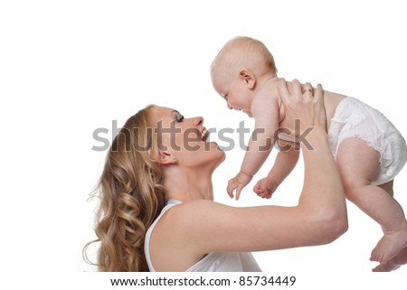 Beauty blond mother smile and take baby - stock photo