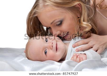 Beauty blond woman kiss a baby - stock photo