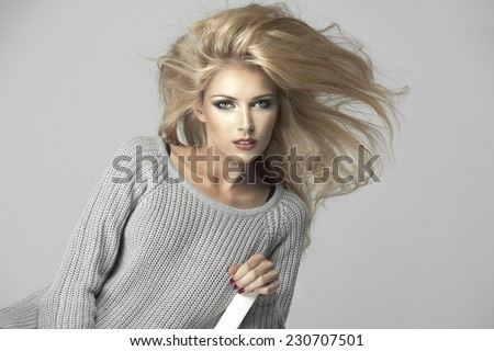 Beauty blond woman on chair - stock photo