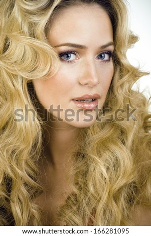 beauty blond woman with long curly hair close up isolated