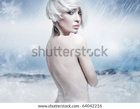 Beauty blonde in the winter scenery - stock photo