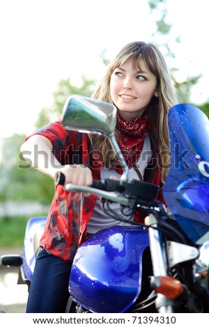 beauty blonde teenager girl drive blue motorcycle