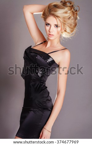 Beauty blonde woman in black dress vogue, fashion model girl with long curly hair bright makeup, Fashion young woman, Beauty girl with blond wavy long hair, Beautiful model girl, isolated studio