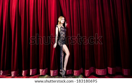 Beauty blonde woman on the stage - stock photo