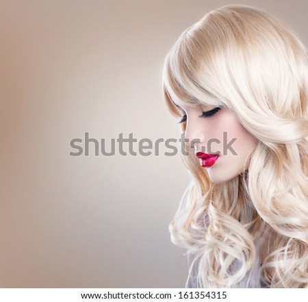 Beauty Blonde Woman Portrait. Beautiful Blond Girl with Healthy Long Wavy Hair. White Hair. Hairstyle. Beauty Sexy Model. Perfect Skin and Make up. Pretty Face. Hair Extensions  - stock photo